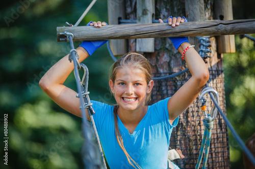 Girl in a climbing adventure park - 80488902