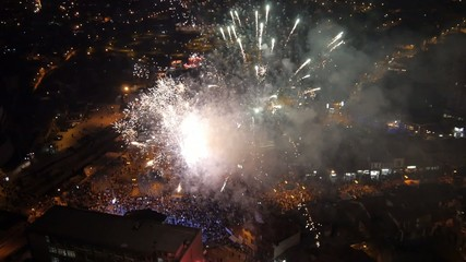 Aerial view on the big fireworks and concert at the city center