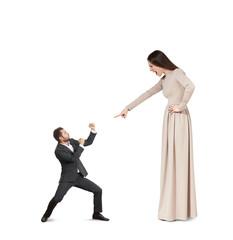 woman pointing at small man