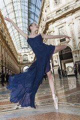 Elegant classical dancer performing in Milan's shopping mall