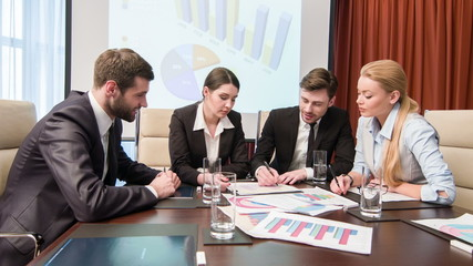 Young business professionals at the meeting
