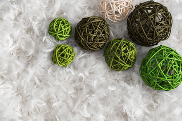 Seven rattan balls on background from feather