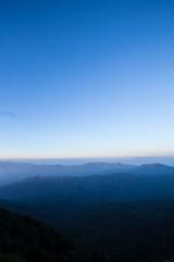 Horizontal, horizontal sunrise sky from mountain peak