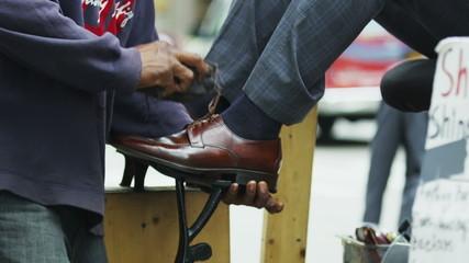 Businessman gets a New York City shoe shine