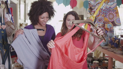Two attractive women shopping together for new clothes