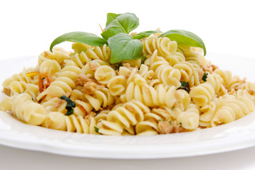 Tuna pasta topped with pesto leaves