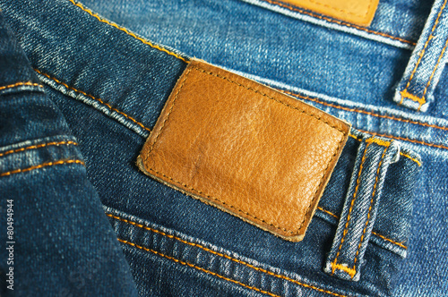Jeans with brown leather label closeup - 80494944