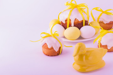 Decorated easter cakes and eggs  in yellow colors. Selective foc