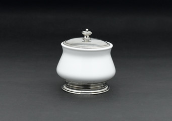 A luxury porcelain sugar bowl with a pewter lid
