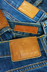 Pile of blue jeans closeup label
