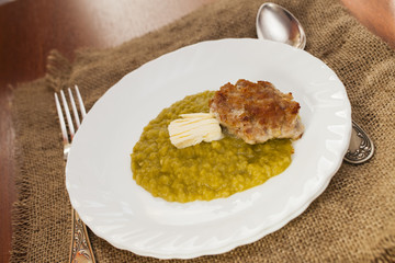 pea porridge with meat cutlet and butter