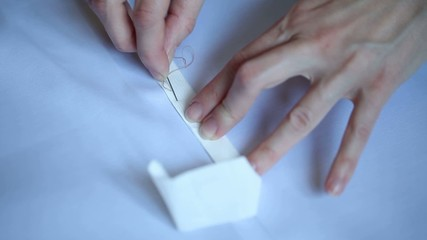 hand sewing tape to the fabric white thread a needle