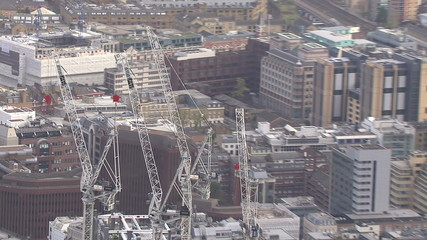 Aerial view of construction cranes in the city of London