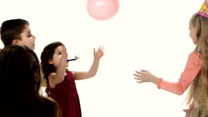 Children having fun after birthday. Play balloons, jumping