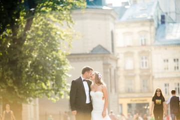 Lovely couple hugging in city. Europe.