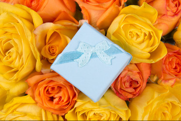 little blue gift box and beautiful bouquet of roses
