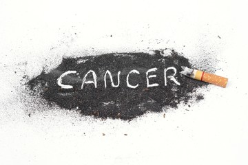 cigarette ash with text saying cancer