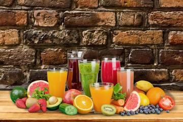 Detox. Fresh vegetable juices on wood plant