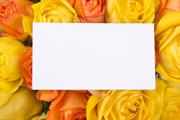 blank gift card and beautiful bouquet of roses