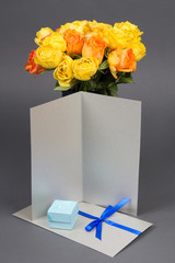 blank gift card, bouquet of orange and yellow rose flowers and g