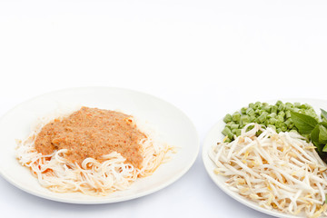 Rice noodles in fish curry sauce and vegetables.
