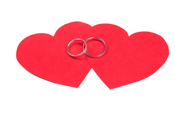 wedding rings on red heart isolated on white