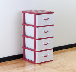 A plastic cabinet with drawers for home or office using