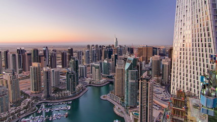 Dubai marina harbor from night to day transition timelapse