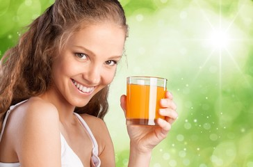 Juice. Young attractive happy woman with glass of juice