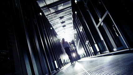Team of IT engineers working in a data centre