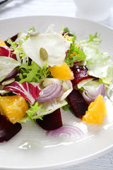 salad with slices of beets and oranges