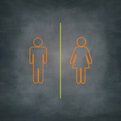 separate man and woman with chalk on blackboard