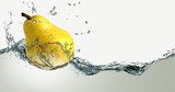 Ripe pear and splashes of water.