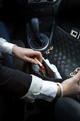 woman searching for things in black handbag