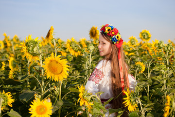 Beautiful young girl at sunflower field