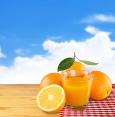 6474. Orange juice in glass with mint,  fresh fruits on wooden