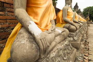 Hands of Buddha statues in a row (focused on the nearest)