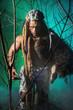 Muscular man werewolf goes through the woods