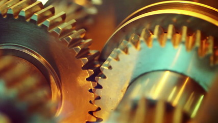 Golden gears with cogs in action. HD 1080p, Loop-ready