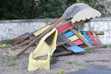 slide broken and abandoned in a deserted playground after the di