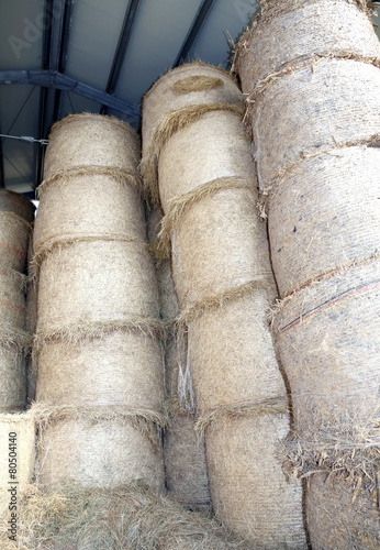big hay bales in the barn of the farm