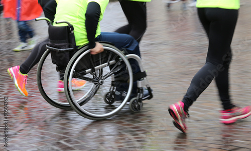 disabled athlete with the wheelchair during a sports competition - 80504362