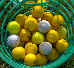 Golf bucket with drivingrange balls  at a golf club