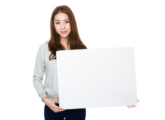 Asian woman holding a blank poster