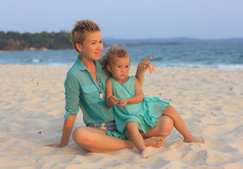 Mother and daughter together on the beach