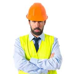 Sad worker over white background