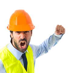 Workman giving punch over white background