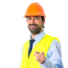Workman pointing to the front