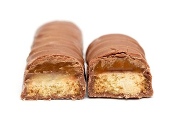Two chocolate bars with caramel and cookie on a white.