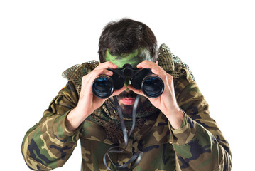 Soldier with binoculars over white background